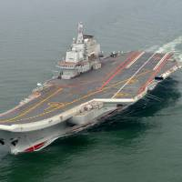 Zone offense: The Chinese aircraft carrier Liaoning is put through its paces at sea in this May 2012 file photo provided by the Xinhua News Agency. | AP