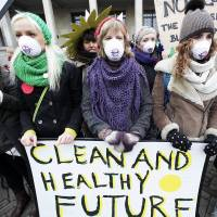 For the future: Girls protest in front of the Polish Ministry of Economy on Monday in Warsaw, where a coal industry meeting was being held. The U.N.'s chief climate diplomat on Monday urged the industry to diversify toward cleaner energy sources and leave most of the world's remaining coal reserves in the ground | AP