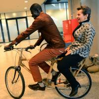 Zero emissions: Christiana Figueres, executive secretary of the United Nations Framework Convention on Climate Change, presents a bamboo bicycle made by Evelyn Ohenewaa Gyasi in Ghana as part of efforts to tackle climate change during a session of United Nations Climate Change Conference on Wednesday in Warsaw. | AFP-JIJI