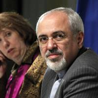 Staking positions: European Union foreign policy chief Catherine Ashton and Iranian Foreign Minister Mohammad Javad Zarif attend a news conference at the end of the Iranian nuclear talks in Geneva on Sunday | AFP-JIJI