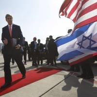 No big strides: Visting U.S. Secretary of State John Kerry walks to his plane Friday after meeting Israeli Prime Minister Benjamin Netanyahu in Tel Aviv. | AP