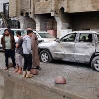 Bomb attack at Iraq marketplace kills 48; year's death toll tops 5,800