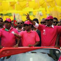 Dynastic choice: Yaamin Abdul Gayoom (center), a brother of the Maldives' longtime former autocratic ruler Maumoon Abdul Gayoom, holds a campaign rally in Male on Friday. In a closely fought runoff election Saturday, voters chose Gayoom as their new president over the country's first democratically elected leader | AP