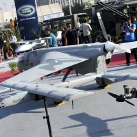 Home-made craft: Visitors look at Pakistan-made drone at a defense exhibition in Karachi last November. The military said Monday it has, for the first time, deployed domestically developed unmanned aircraft. | AP