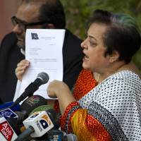 Backlash: Shireen Mazari, information secretary of the Pakistan Tehreek-e-Insaf party, shows a document during a news conference in Islamabad on Wednesday. | AP