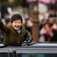 Seeking an apology: South Korean President Park Geun-hye heads to the presidential office following her February inauguration in Seoul | BLOOMBERG