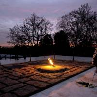 Extinguished dreams: The eternal flame flickers in the early morning light at the grave of John F. Kennedy at Arlington National Cemetery in Arlington, Virginia, on Friday, the 50th anniversary of Kennedy's death. | AP