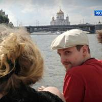 Glasses off, beard on: Former National Security Agency contractor Edward Snowden rides on a boat on the Moscow River in September in a TV grab distributed Friday | AP