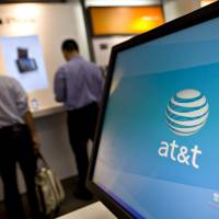 CI&A: Customers browse inside an AT&T store in New York City. The largest U.S. phone company receives more than $10 million annually from the CIA to provide phone records with possible links to suspected terrorists, a report said Thursday | BLOOMBERG