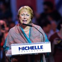 Final pitch: Michelle Bachelet, Chile's former president and a candidate for the country's presidential election Sunday, delivers a speech Thursday in Santiago at the final rally of her election campaign | AFP-JIJI