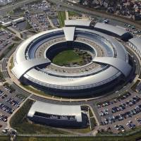 Ringed in: Britain's Government Communications Headquarters (GCHQ)— a giant, ring-shaped building nicknamed 'the doughnut' — is seen in an aerial shot in Cheltenham, England, in September 2004. | AFP-JIJI