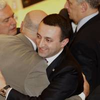 Georgian Prime Minister Irakli Garibashvili (center) is congratulated after being approved as prime minister in the parliament in Kutaisi, 250 km west of Tbilisi, on Wednesday. | AP