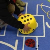 Rolling the dice: A preschool child plays on a carpet at a kindergarten in Eichenau, near Munich, on Oct. 9 | AFP-JIJI