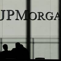 Financial security:  The JPMorgan Chase & Co. logo is displayed at their headquarters in New York on Oct. 21. The bank, the largest in the U.S., said Friday that it had reached a $4.5 billion settlement with investors over mortgage-backed securities. | AP
