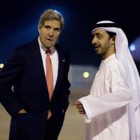 Warning: Vising U.S. Secretary of State John Kerry is greeted by the United Arab Emirates' foreign minister upon his arrival in Abu Dhabi on Sunday. Kerry on Wednesday warned the U.S. Congress that forging ahead with new sanctions against Iran could harm a potentially historic opportunity to agree a nuclear pact with Tehran | AFP-JIJI