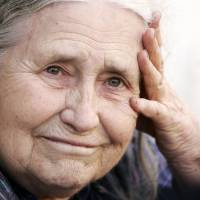 An 'epicist of the female experience': Doris Lessing, returning to her home in north London from a shopping trip on Oct. 11, 2007, reacts after being told by photographers that she had won the Nobel Prize in literature. | AFP-JIJI