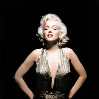 Sex symbol: Marilyn Monroe is shown wearing a knife-pleated gold lame gown made from 'one complete circle of fabric,' which she wore in 'Gentlemen Prefer Blondes.' Medical files proving the Hollywood screen siren underwent cosmetic surgery sold for $25,600 during a weekend auction in California | AP