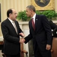 Obama meets Iraq's al-Maliki, remains mum on arms sales