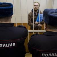 Russian court frees two Greenpeace members on bail
