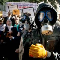 No masking their intentions: Albanian environmental activists protest in the capital, Tirana, on Nov. 7 against the prospect of using Albania as a site for destroying Syria's chemical weapons stockpile. | AFP-JIJI