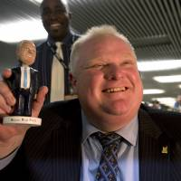 Blame it on the booze: Toronto Mayor Rob Ford (above) holds a bobblehead doll of himself at City Hall on Tuesday. Former Las Vegas Mayor Oscar Goodman made headlines by angrily threatening to blow off an interview Sunday with CNN's travel show 'Parts Unknown,' but on Wednesday explained that he was three Martinis in at the time and noted that he at least hadn't been smoking crack, unlike Ford | AP
