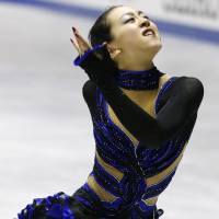 Cold war: Mao Asada is looking forward to competing against rival Kim Yu-na on the ice during the Sochi Olympics | KYODO