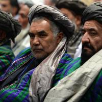 Powwow: Members of the Afghan Loya Jirga, a meeting of around 2,500 Afghan tribal elders and leaders, listen during the first day of a four-day Loya Jirga in Kabul on Thursday. | AFP-JIJI