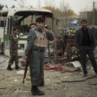 Suicide bomb rocks Kabul as Afghan chief announces draft of key security deal