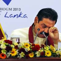In the spotlight: Sri Lankan President Mahinda Rajapaksa rubs his eyes at a media briefing on the final day of the Commonwealth Heads of Governments Meeting in Colombo on Sunday | AP