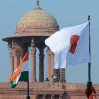Welcoming sign: The Japanese and Indian flags fly in front of the Indian Secretariat on Rajpath in New Delhi on Saturday, ahead of a state visit by Emperor Akihito and Empress Michiko. The Imperial Couple arrived in the city Saturday for a six-day visit. | AFP-JIJI