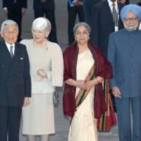 At ease: Emperor Akihito and Empress Michiko pose for a photo in New Delhi with Indian Prime Minister Manmohan Singh and his wife, Gursharan Kaur, after arriving for an official state visit Saturday. | POOL