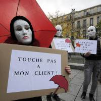 French lawmakers vote to penalize clients of sex workers