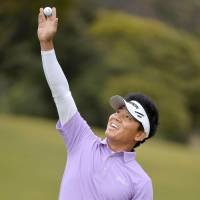 Big win: China's Wu Ashun gestures in triumph after finishing the final round to win the Heiwa PGM Championship Sunday in Miho, Ibaraki Prefecture | KYODO