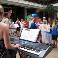 For gay nuptials: Pianist Angie Delight leads proponents of gay marriage in a song before a House floor session at the Hawaii Capitol in Honolulu on Nov. 8 | AP