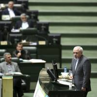 Opening up?: Iranian Foreign Minister Mohammad Javad Zarif speaks in the legislature in Tehran on Wednesday. | AP