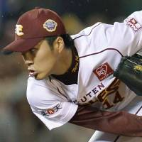 Mission accomplished: The Eagles' Takahiro Norimoto tosses two scoreless innings to keep the shutout intact before making way for ace Masahiro Tanaka in the ninth | KYODO