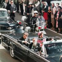 Never forgotten: President John F. Kennedy's motorcade travels through Dallas on Nov. 22, 1963, minutes before he is assassinated. | AP