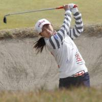 Title chase: Sakura Yokomine hits out of a bunker on the fourth hole at the Japan LPGA Tour Championship on Thursday in Miyazaki. | KYODO