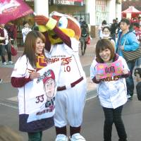 Loyal supporters: Eagles fans Hiroko Takami (left) and Yachiyo Matsuya soak in the excitement at the Japan Series before Game 6 at Kleenex Stadium on Saturday | KAZ NAGATSUKA