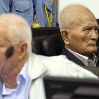 What genocide?: Khieu Samphan (left), the Khmer Rouge's former head of state, and Nuon Chea, the group's chief ideologist and No. 2 leader, sit Thursday in the hall of the Extraordinary Chambers in the Courts of Cambodia in Phnom Penh. In their closing statements the same day at the U.N.-backed war crimes tribunal, the last two surviving leaders of the Khmer Rouge regime still on trial for genocide and other war crimes tried to distance themselves from the deaths of more than 1.7 million people during their rule | AP