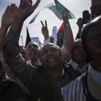 Libyan rage: Men shout slogans against Tripoli-based militias and in support of Libya's new national army and the police corps during a protest in the capital on Friday. | AP