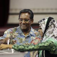 One vote: Maldives President Mohamed Waheed Hassan casts his vote in Male on Nov. 9. After two months of political bickering and repeated failure to hold an election, voters head to the polls Saturday to elect a new president for their vulnerable new democracy. | AP