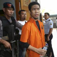 Plot foiled: Suspected militant Separiano is escorted by uniformed and plainclothes police upon arrival for his trial in South Jakarta District Court on Wednesday. He stands accused of conspiring to attack the Myanmar Embassy in Jakarta | AP