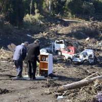 Izu-Oshima Island holds memorial for mudslide victims of Typhoon Wipha