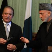 Man of peace: Afghan President Hamid Karzai (right) meets with Pakistani Prime Minister Nawaz Sharif at the Presidential Palace in Kabul on Saturday. Sharif said he supported Afghan efforts to seek peace with the Taliban. | AFP-JIJI
