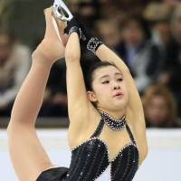 Rough start: Kanako Murakami skates in the women's short program on Friday at the Cup of Russia in Moscow. Murakami is in last place in the nine-woman field with 49.24 points. | KYODO