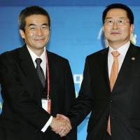 Japan, South Korea discuss North Korea concerns, 'collective self-defense'