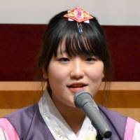 Stuff of dreams: Kim Nae Yong from South Korea speaks during a Japanese speech contest in the city of Okayama Friday | KYODO