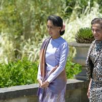 Making history: Myanmar opposition leader Aung San Suu Kyi (left) strolls with New South Wales Gov. Marie Bashir on Wednesday in the gardens of Government House in Sydney. | AFP-JIJI