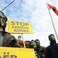 Not in our backyard: Demonstrators holding signs reading 'Stop chemical weapons' stage a protest Nov. 14 in front of the Albanian Embassy in Skopje over the possibility that Albania may process and destroy 1.000 tons of chemical weapons from Syria. | AFP-JIJI